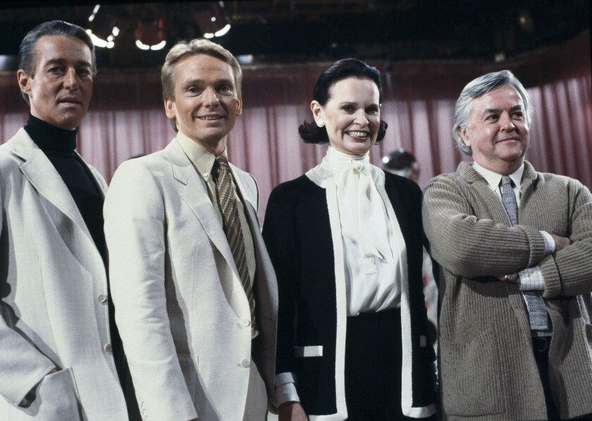 """In this file photo, fashion designers David Halston, from left, Bob Mackie, Gloria Vanderbilt and Geoffrey Beene pose on the set of the """"Love Boat"""" at Warner Bros. Studio in Los Angeles."""