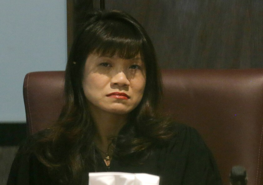 FILE - In this Tuesday, Oct. 22, 2013, file photo, Oklahoma County Judge Cindy Truong listens to testimony in court in Oklahoma City. On Monday, Oct. 4, 2021, Truong temporarily blocked two new anti-abortion laws from taking effect in the following month, including a measure similar to a Texas abortion ban that effectively prohibits abortions after about six weeks of pregnancy. (AP Photo/Sue Ogrocki, File)