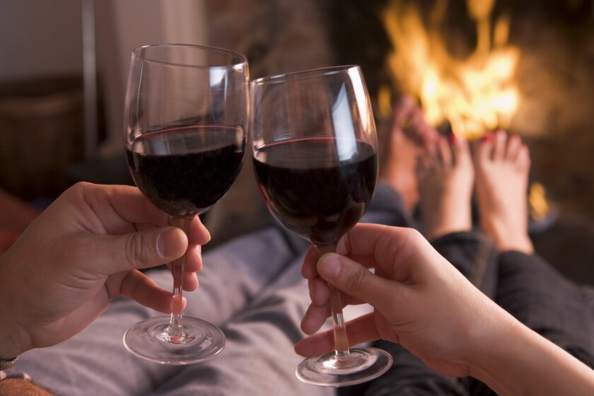 Cozy up next to the fire and make sure to bring one of these top red wines for cold weather. (iStock)