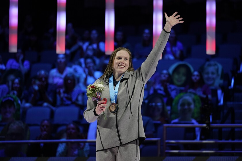 Lilly King waves at the awards ceremony after winning the women's 100 breaststroke during wave 2 of the U.S. Olympic Swim Trials on Tuesday, June 15, 2021, in Omaha, Neb. (AP Photo/Charlie Neibergall)