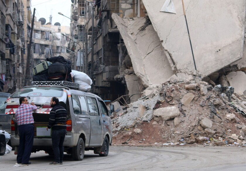 The streets in much of Aleppo, Syria, are clogged by masses of rubble.