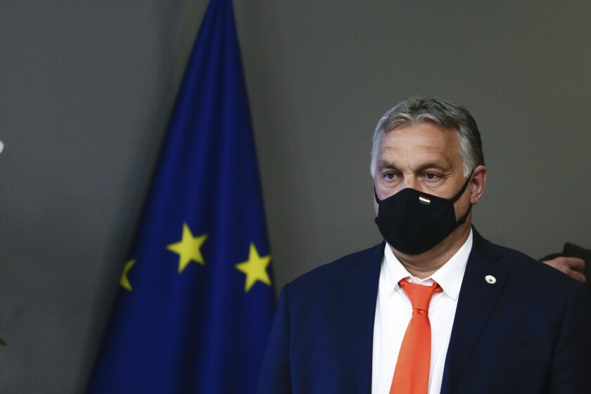 Hungary's Prime Minister Viktor Orban leaves at the end of the first day of an EU summit at the European Council building in Brussels, early Friday, June 25, 2021. At their summit in Brussels, EU leaders are set to take stock of coronavirus recovery plans, study ways to improve relations with Russia and Turkey, and insist on the need to develop migration partners with the countries of northern Africa, but a heated exchange over a new LGBT bill in Hungary is also likely. (Aris Oikonomou, Pool Photo via AP)