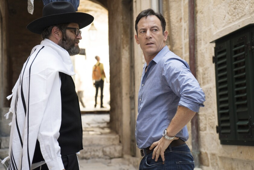 """Jason Isaacs, right, as Peter Connelly in the USA series """"Dig."""""""
