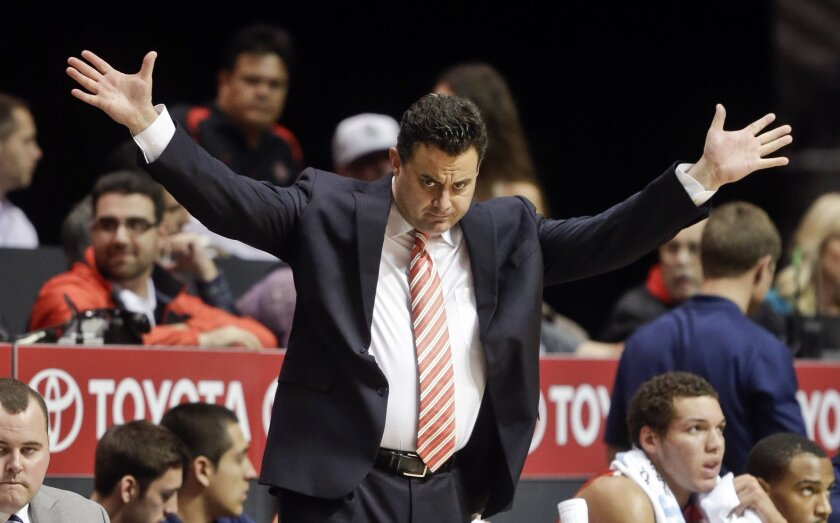 Arizona coach Sean Miller, returning to Viejas Arena with the Wildcats for the NCAA tournament, here gestures to his team during an early-season win at San Diego State. (AP Photo/Lenny Ignelzi)