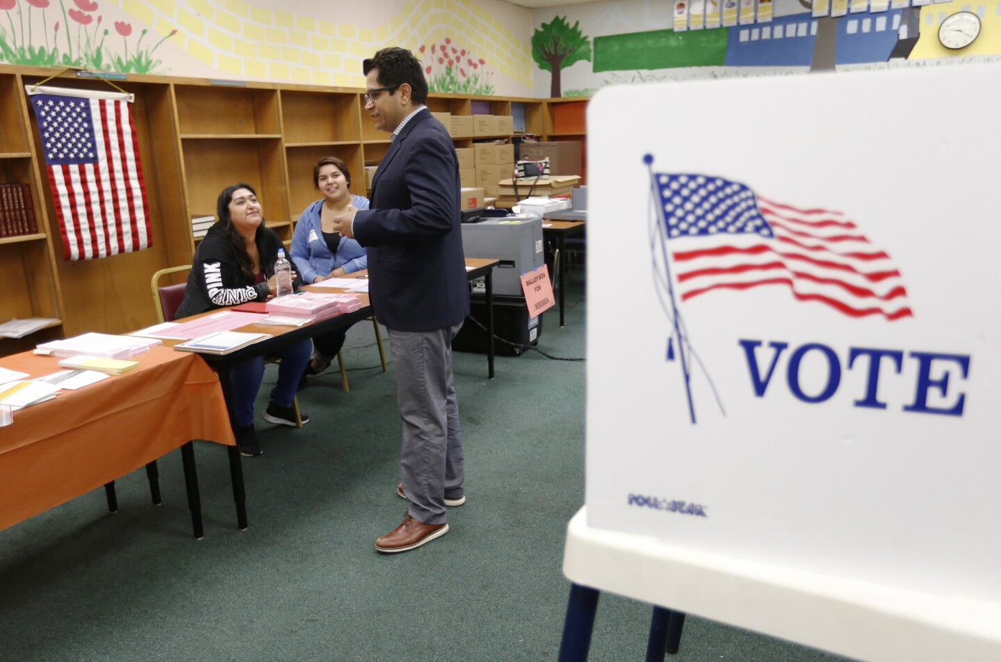 LOS ANGELES, CA - JUNE 6, 2017 -- Jimmy Gomez thanks poll volunteers at Sheridan Street School in Boyle Heights as he is walking the precinct Tuesday morning June 6, 2017 in a last effort to get out the vote as he runs for the 34th congressional district special election to replace the seat vacated by California Attorney General Xavier Becerra. Tuesday's election is between Jimmy Gomez and Robert Ahn for the 34th congressional district of Los Angeles. (Al Seib / Los Angeles Times)