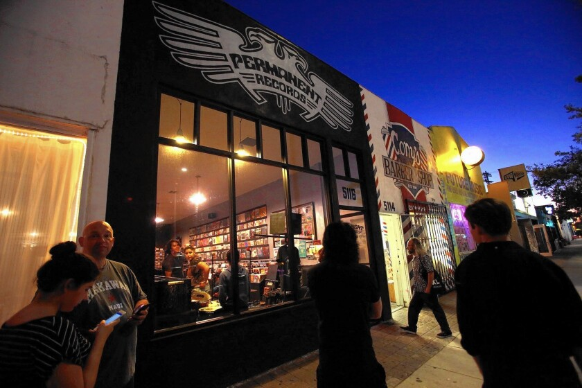 People wait for an in-store performance by the Southern California band Dabble at Permanent Records on York Avenue in Highland Park, which has become a hub for musicians, record stores and music labels but lacks a great performance venue.