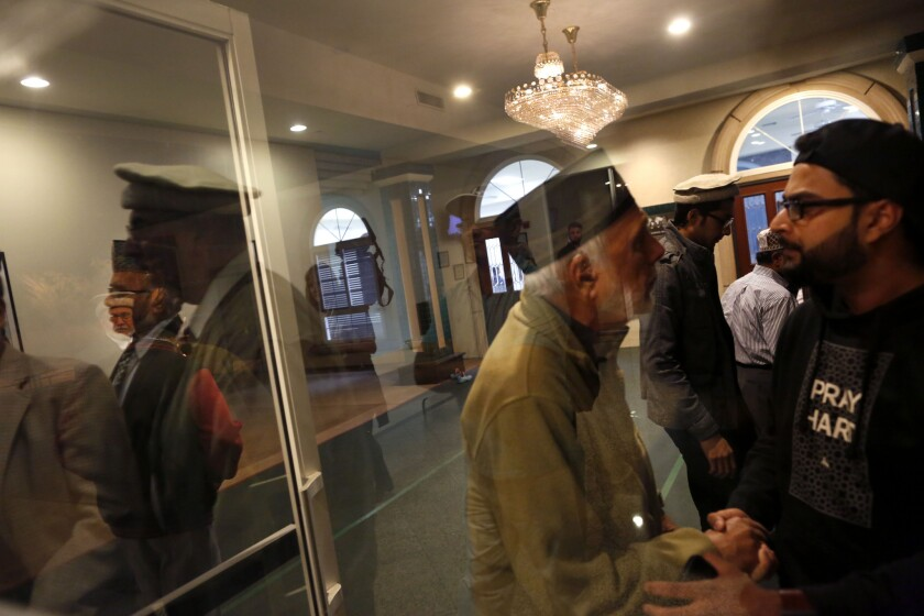Members of the Baitul Hameed Mosque in Chino gather before a prayer service held by the Los Angeles Ahmadiyya Muslim Community at the mosque on Thursday, the day after the San Bernardino attack. The mosque will host a blood drive on Sunday.
