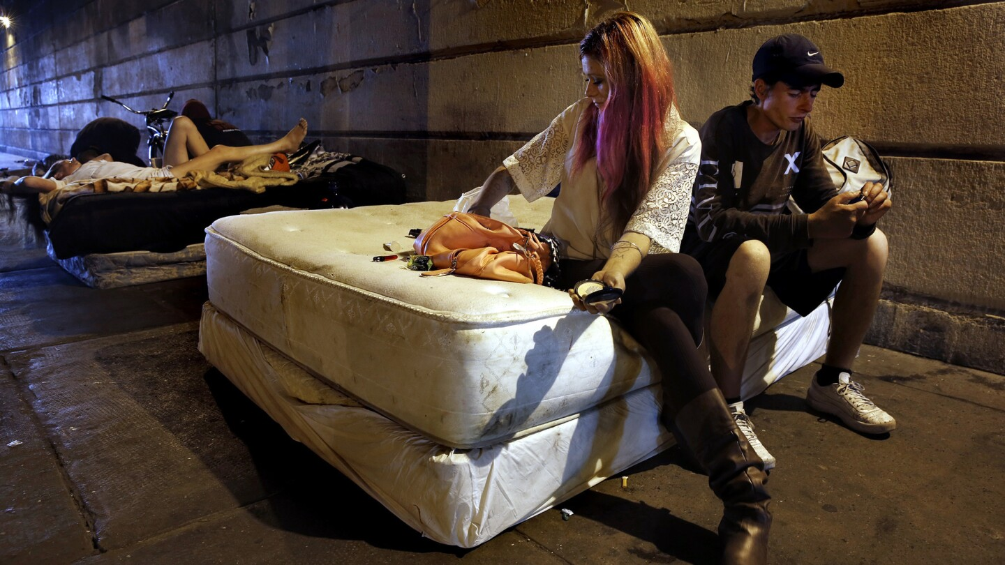 Christina Gambrill, 31, and her boyfriend, Justin Smith, 32, a former aricraft technician, sleep under the Emerald Street bridge. They both say they are addicted to heroin.