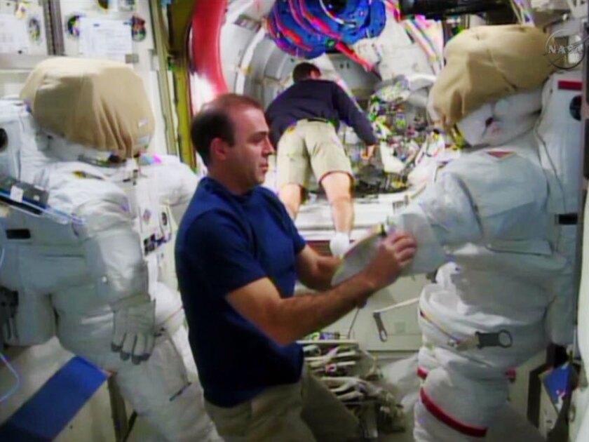 Astronauts prepare for spacewalk repair mission