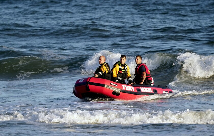 NYPD/FDNY divers were scouring the waters off the Rockaways Saturday after receiving a report of a missing 17-year-old swimmer.