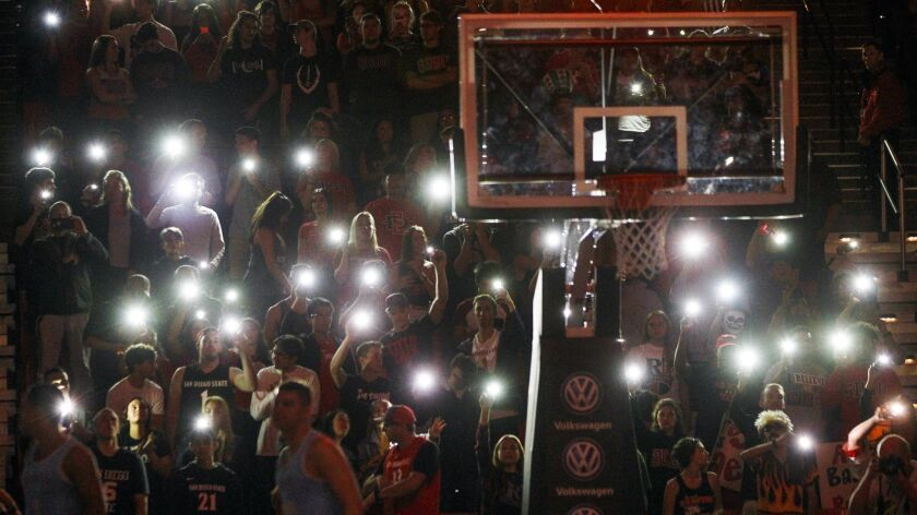 Aztecs fans light up their cell phones as SDSU players are introduced before a game against San Diego Christian at Viejas Arena last season.