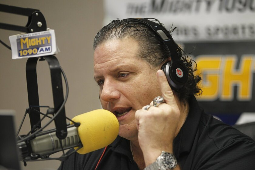 Radio personality Dan Sileo does his morning drive time show on AM 1090 on Friday in San Diego, California.
