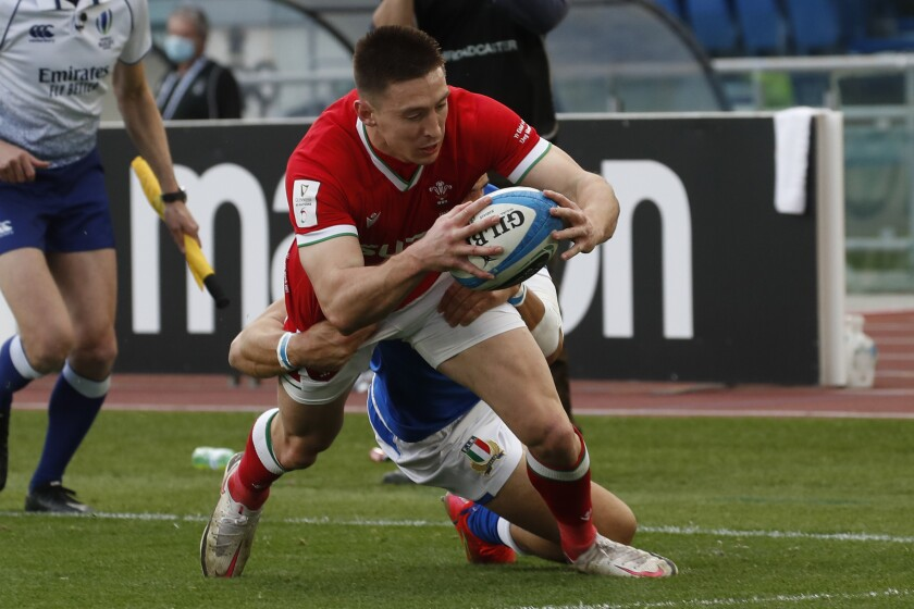 Wales'Josh Adams scores a try during the Six Nations rugby union match between Italy and Wales, in the Olympic stadium in Rome, Italy, Saturday, March 13, 2021. (AP Photo/Alessandra Tarantino)