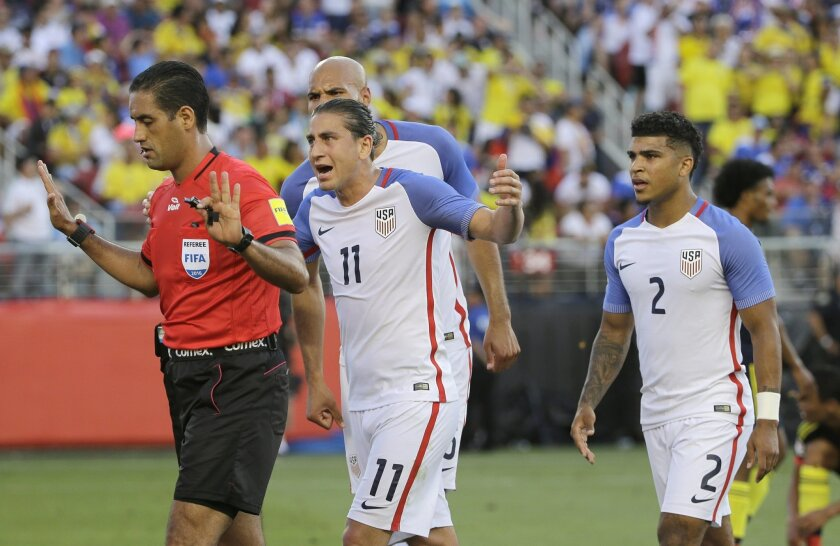 Alejandro Bedoya of the United States argues with referee Roberto García Orozco, after he awarded a penalty to Colombia during the opening match of the Copa America Centenario at Levi's Stadium in Santa Clara, Calif., Friday, June 3, 2016. (AP Photo/Jeff Chiu)