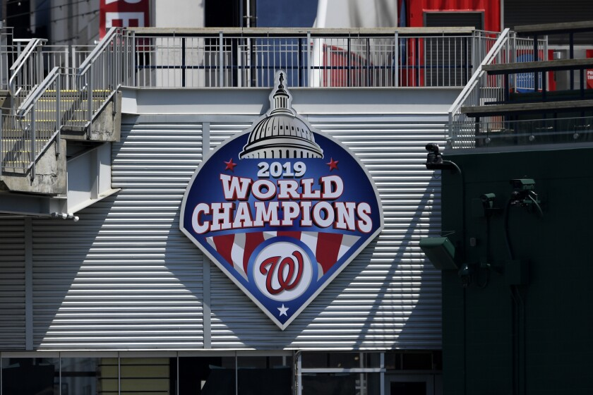 A 2019 World Series champions sign is displayed during the Washington Nationals baseball practice at Nationals Park.