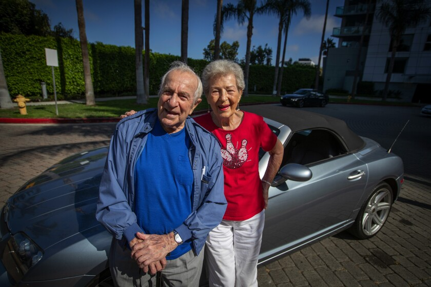 Lillian Solomon with her 99-year-old boyfriend, Eddie Huyffer, in front of her Crossfire convertible. They first met 25 years ago while bowling.