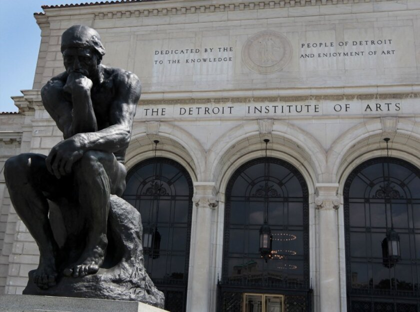 """Auguste Rodin's """"The Thinker"""" on view in front of the Detroit Institute of Arts."""
