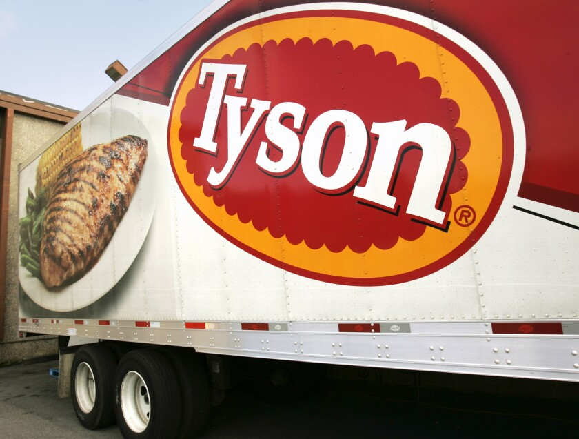 In this Wednesday, Oct. 28, 2009, file photo, a Tyson Foods, Inc., truck is parked at a food warehouse in Little Rock, Ark. Tyson Foods is buying the Nebraska company that makes the Smart Chicken brand of air-cooled chicken.
