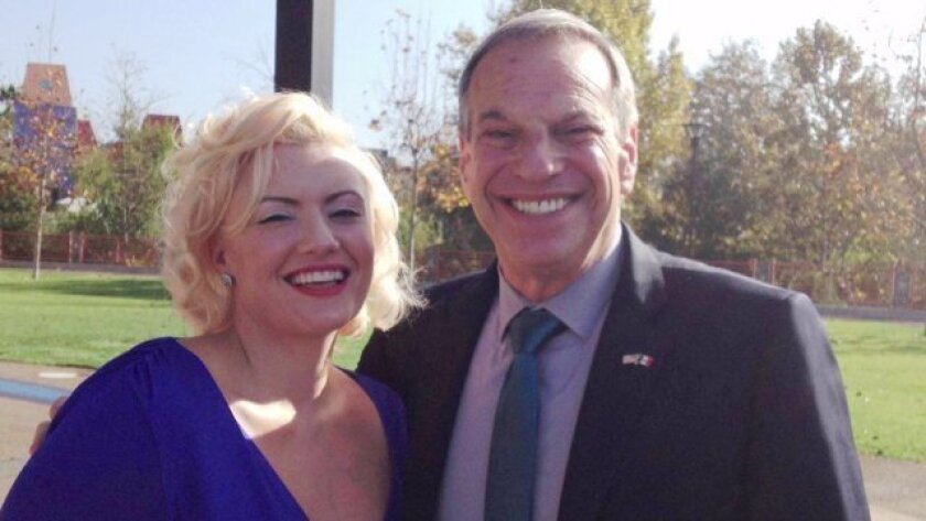 Emily Gilbert poses with Mayor Bob Filner at an event in December 2012.