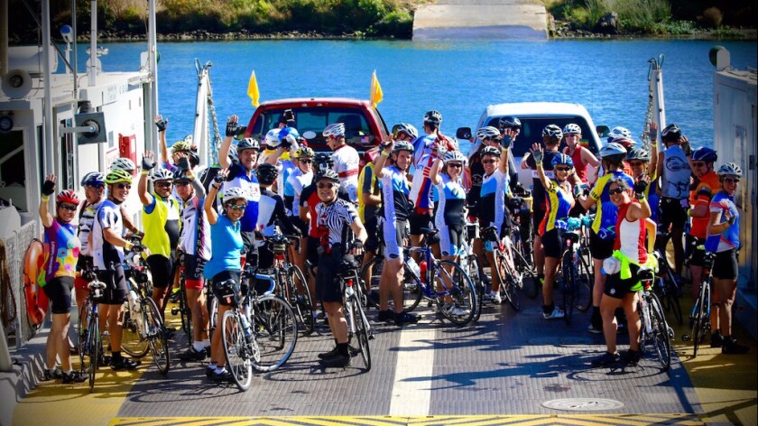 Bicyclists participating in the Sacramento Century Challenge cross on the J-Mac Ferry in the Sacramento Delta.