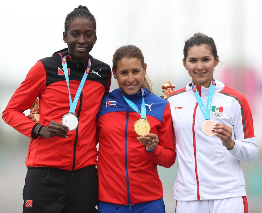 From L to R Trinidad and Tobago's Teniel Campbell, Cuba's Arlenis Sierra and Mexico's Ariadna Gutierrez stand at the podium after winning the silver, gold and bronze medals respectively in the Cycling Road Race Women's Finals at the Lima 2019 Pan-American Games in Lima on August 10, 2019. (Photo by LUKA GONZALES / AFP)LUKA GONZALES/AFP/Getty Images ** OUTS - ELSENT, FPG, CM - OUTS * NM, PH, VA if sourced by CT, LA or MoD **