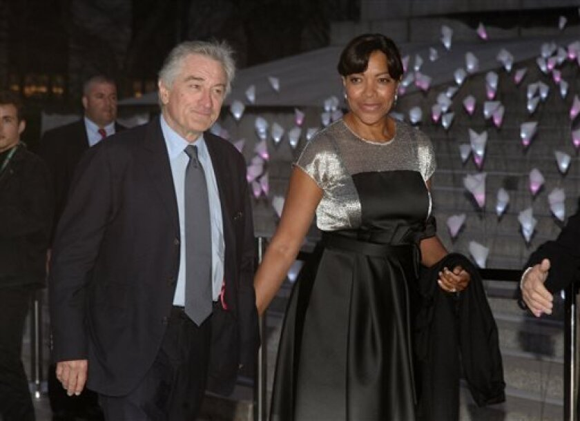 Actor Robert DeNiro, left, and his wife Grace Hightower, attend the Vanity Fair Tribeca Film Festival Party, on Tuesday, April 16, 2013, in New York. (Photo by Andy Kropa/Invision/AP)
