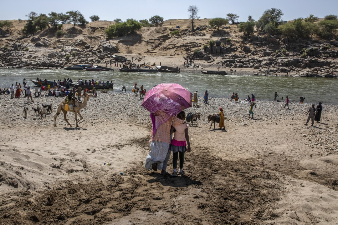 Refugees from Tigray arrive on the banks of the Tekeze River on the Sudan-Ethiopia border