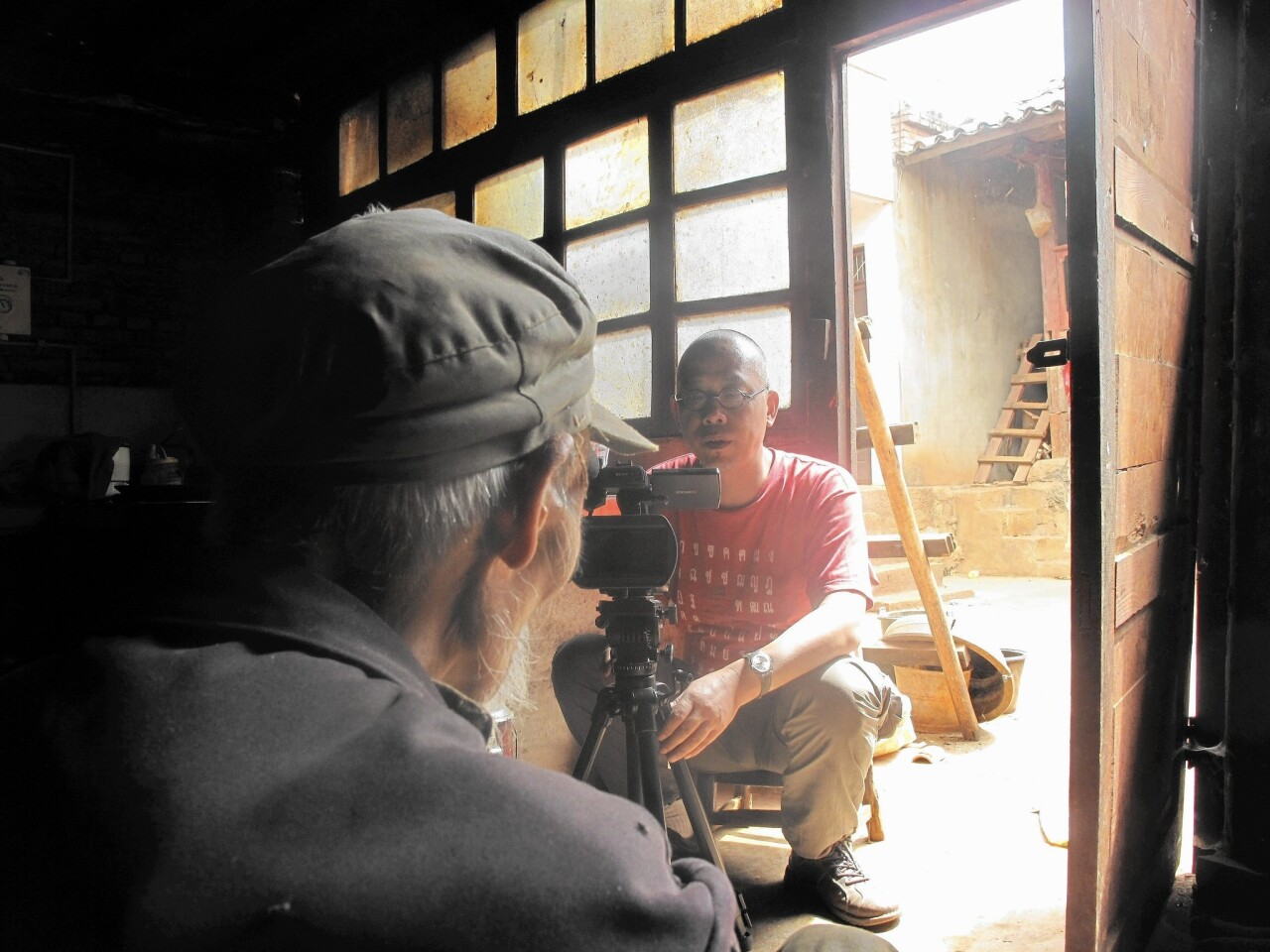 "Wu Wenguang works on his ""Memory Project"" documenting villagers' firsthand accounts of China's Great Famine, which lasted from 1958 to 1961."