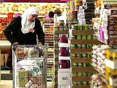 A shopper at Al Tayebat Grocery