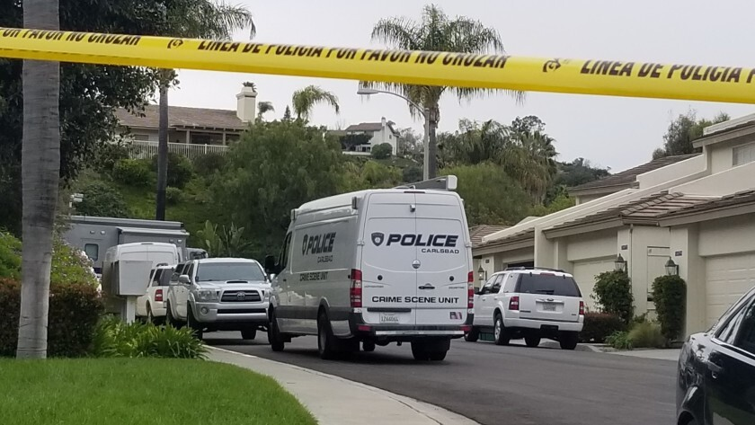 Carlsbad police cordoned off part of Outrigger Lane in March as they investigated the stabbing death of Marjorie Gawitt. A preliminary hearing in the case began in Vista on Wednesday.