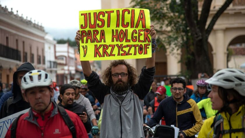 Friends of Holger Franz Hagenbusch and Krzysztof Chmielewski-Podroznik, cyclists who disappeared in the Mexican state of Chiapas, protest May 6 in San Cristobal de las Casas.