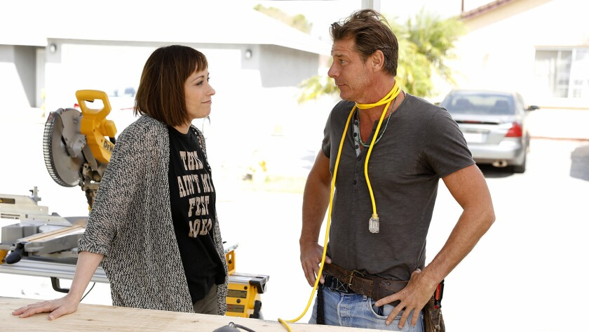 """Host Paige Davis and carpenter Ty Pennington in the revival of the home redecorating series """"Trading Spaces"""" on TLC."""
