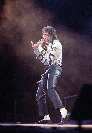At the height of his career in the mid-1980s, he was a fresh representation of how a male pop singer could look, with his perfectly chiseled face, long curls, white T-shirt, black pegged pants, white ankle socks and black loafers. Reminiscent of a dancer's costume, the graphic black-and-white enhanced his unbelievable moves.