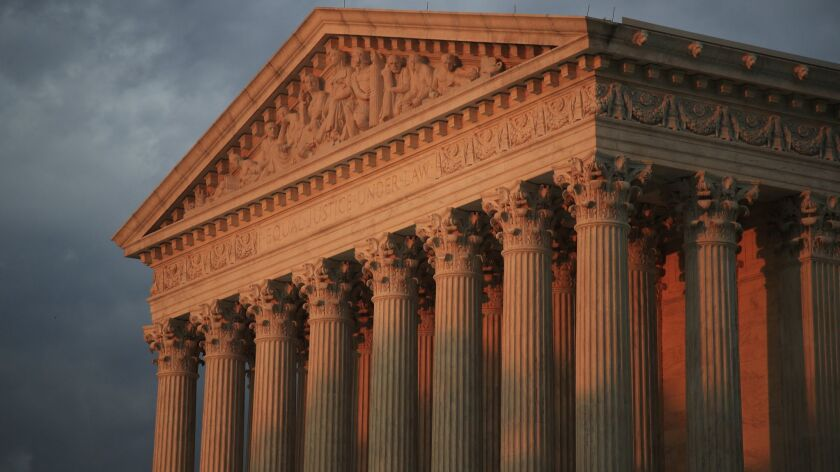 FILE - In this Oct. 4, 2018 file photo, the U.S. Supreme Court is seen at sunset in Washington. Texa