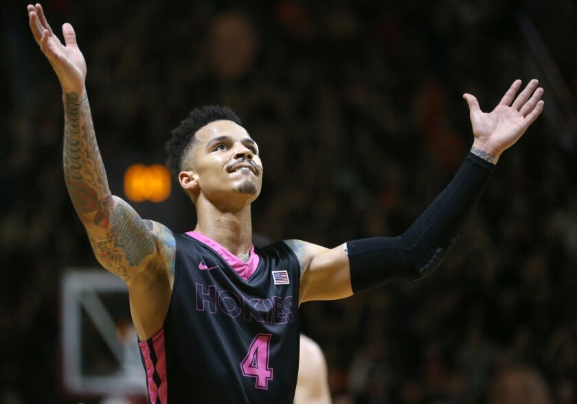 Virginia Tech's Seth Allen (4) celebrates after defeating Florida State in an NCAA college basketball game in Blacksburg, Va. Saturday, Feb. 20, 2016. Virginia Tech won 83-73. (Matt Gentry /The Roanoke Times via AP) LOCAL TELEVISION OUT; SALEM TIMES REGISTER OUT; FINCASTLE HERALD OUT; CHRISTIANBURG NEWS MESSENGER OUT; RADFORD NEWS JOURNAL OUT; ROANOKE STAR SENTINEL OUT; MANDATORY CREDIT