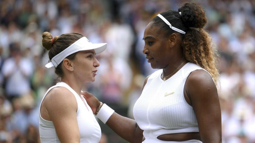 Romania's Simona Halep hugs United States' Serena Williams after defeating her in the women's single