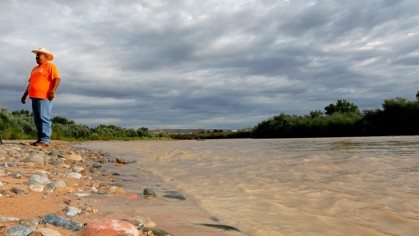 Davis Filfred walks along the San Juan River in Montezuma Creek, Utah, near where the spill took place.