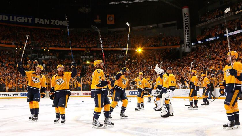 The Nashville Predators raise their sticks to thank the fans after wrapping up their Western Conference semifinal series against St. Louis with a 3-1 victory on May 7.