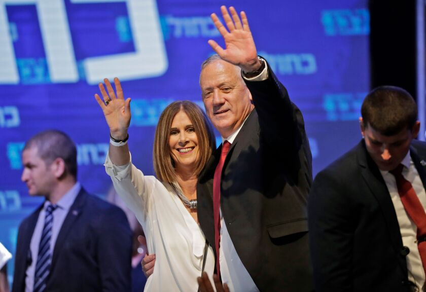 Benny Gantz with his wife, Revital, at campaign headquarters in Tel Aviv on Sept. 18.