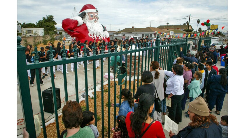 Nov. 28, 2003: Well-wishers gather at the dedication ceremony for the 5-ton statue at the new Santa