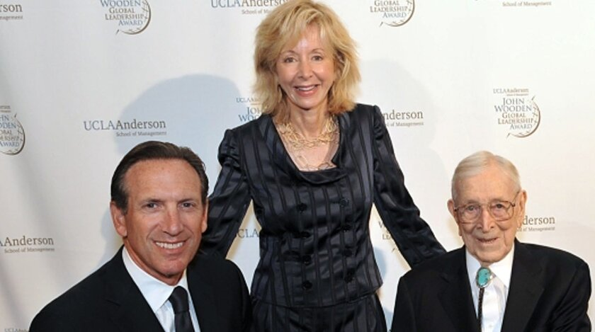 Travel expenses by Judy Olian, Dean of the UCLA Anderson School of Management, center, have come under scrutiny. Here she's seen with Starbucks Chairman and CEO Howard Schultz, left, and John Wooden, right. (PRNewsFoto/UCLA Anderson School of Management)