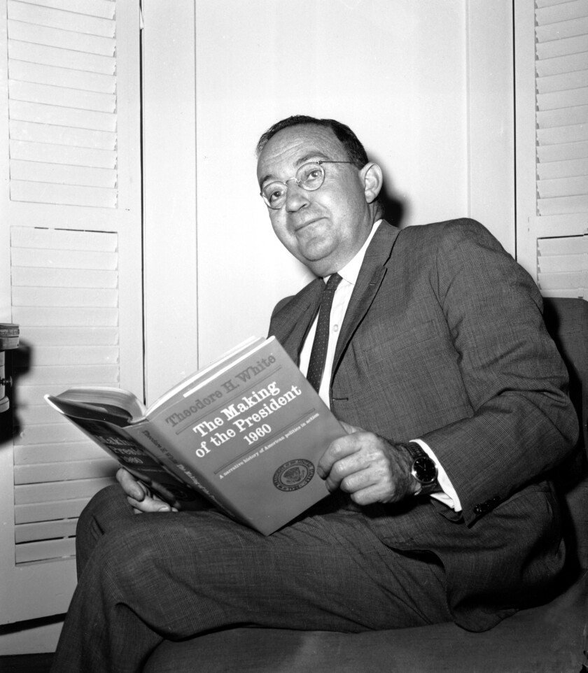 """Theodore H. White poses in his New York City apartment with """"The Making of a President, 1960."""""""