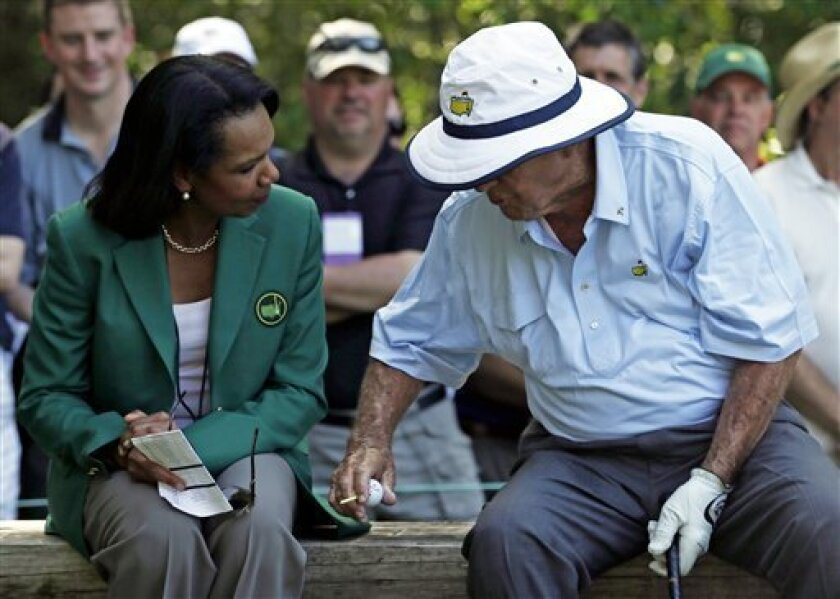 Arnold Palmer speaks with former Secretary of State Condoleezza Rice during the par three competition before the Masters golf tournament Wednesday, April 10, 2013, in Augusta, Ga. (AP Photo/David J. Phillip)