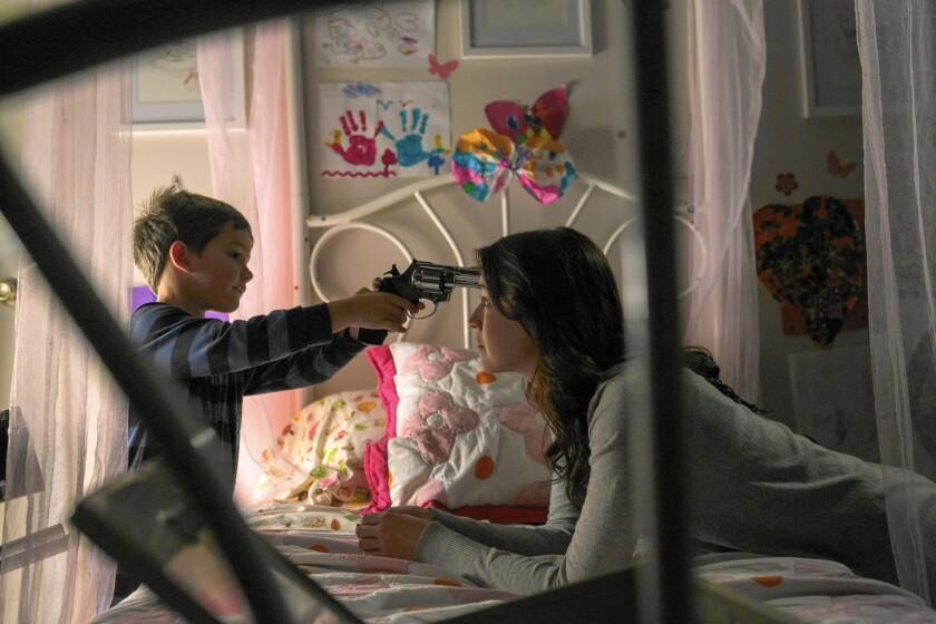 """Sarah Bolger stars as Emelie and Thomas Bair as Christopher in """"Emelie."""""""