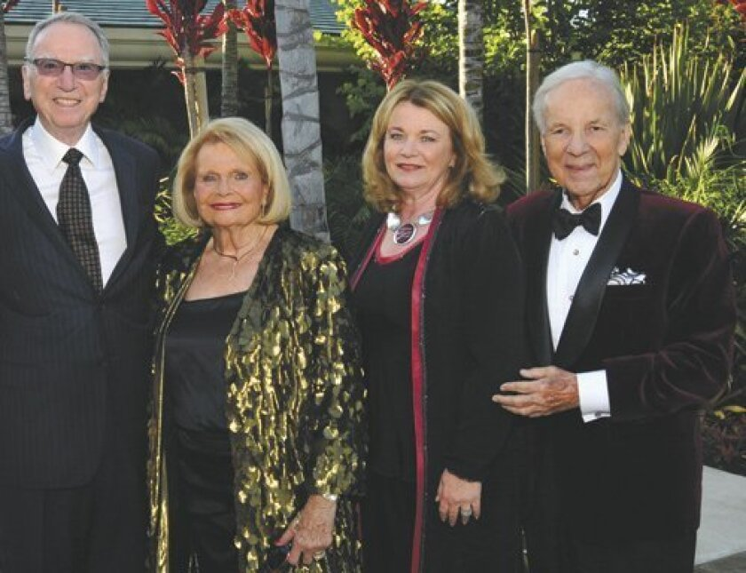 Pictured at La Jolla Music Society's SummerFest gala on Aug. 9 in Rancho Santa Fe are Irwin and Joan Jacobs with Debbie Turner and Conrad Prebys. (Photo by Vincent Andrunas)