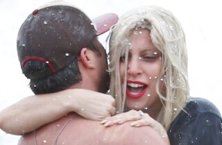 Lady Gaga and fiancé Taylor Kinney jump into icy waters for charity