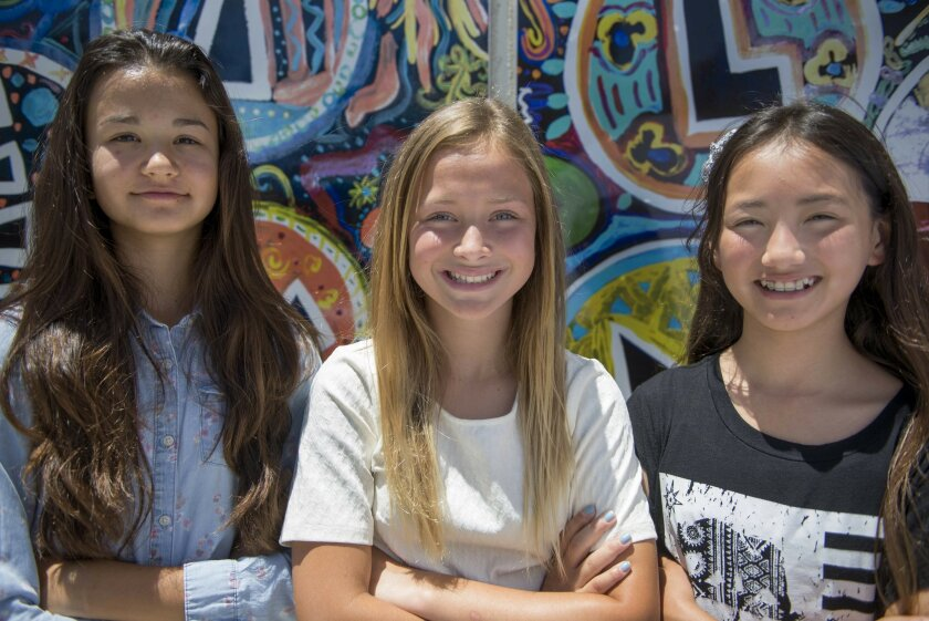 Sixth graders from Vista Magnet Middle School, from left to right, Victoria Arseneault, Karsyn Lee and Lexie Kondo, were selected to have their experiment sent to the International Space Station later this year.