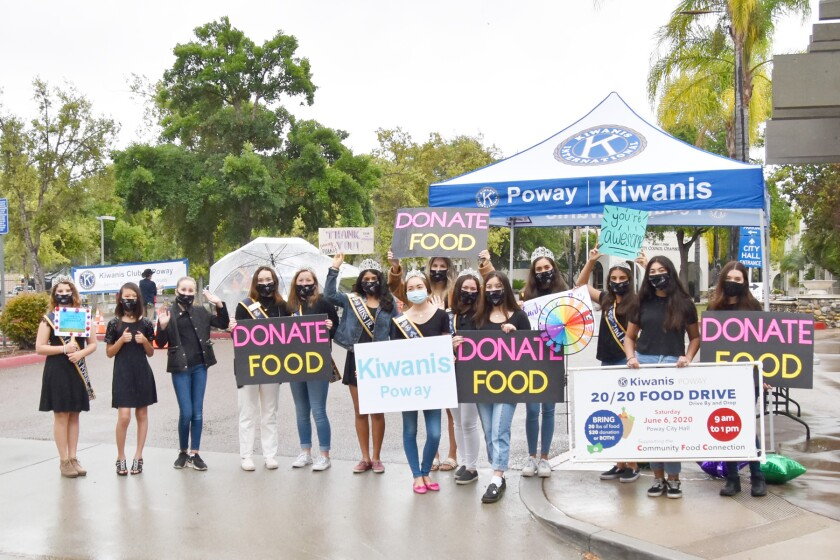 The Poway Princesses of the Miss Poway Scholarship Pageant promoting the food drive at the entrance to City Hall.