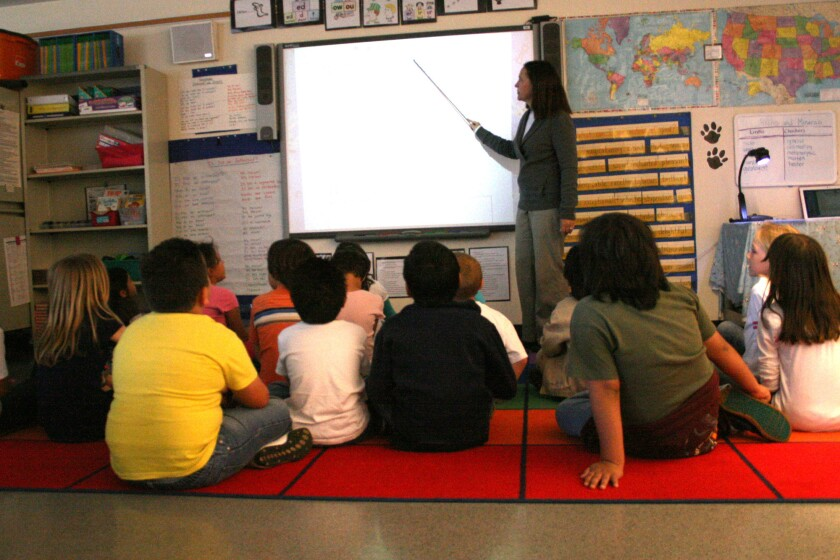 A second-grade teacher leads a geology lesson on a SmartBoard at Joseph R. Perry Elementary School, which a Huntington Beach City School District task force has recommended for closure.(File Photo)