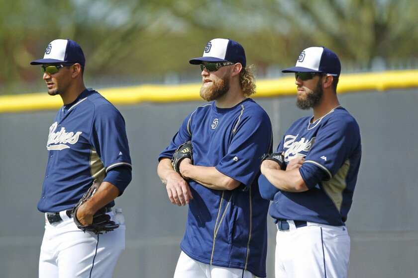 Padres pitchers Tyson Ross, left, Andrew Cashner, and James Shields watch batting practice during a spring training practice.